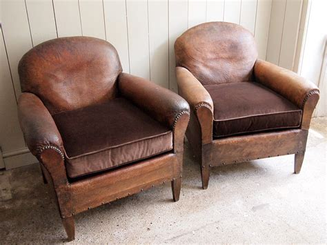 Pair Of Leather Club Chairs › Puckhaber Decorative