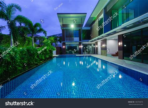 Modern House With Swimming Pool At Night Stock Photo