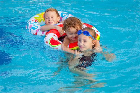 Happy Little Children Playing In The Swimming Pool Stock