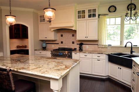 white kitchen cabinets and granite countertops 10 reasons why you need granite countertops in your 2051