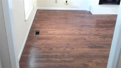 laminate flooring doorway laminate flooring flowing between rooms without a t molding youtube