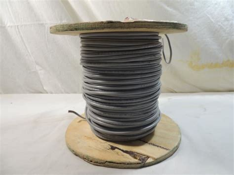 wooden spool grey electrical wire