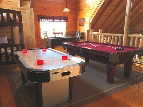 resort cabin indooroutdoor pool game room warcade putt