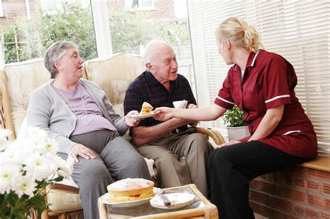 elderly couple and care worker cava