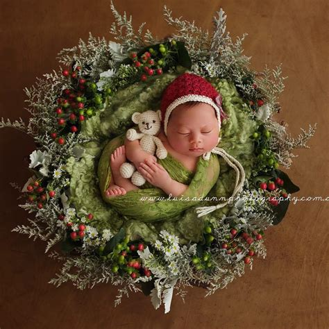 newborns wearing knitted christmas outfits