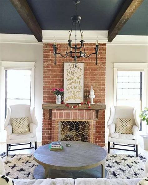 stunning red brick fireplace living room  navy painted