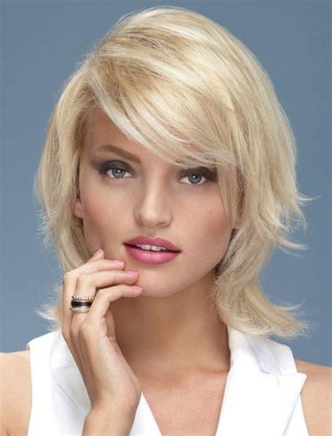 medium length layered hair  bangs hairstyle