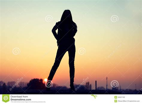 silhouette  seductive woman  rooftop  urban sunset