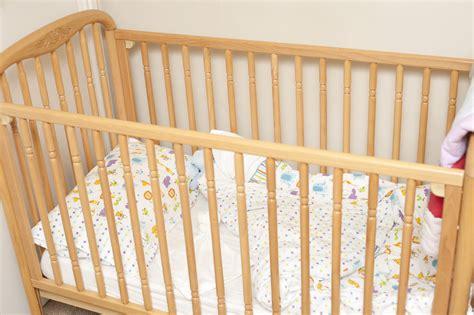 Free Stock Photo 11954 Empty Wooden Baby Crib