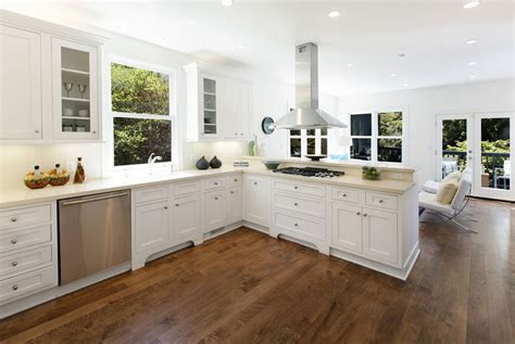 white kitchen cabinets with cherry wood floors hardwood floors in the kitchen pros and cons designing 2205