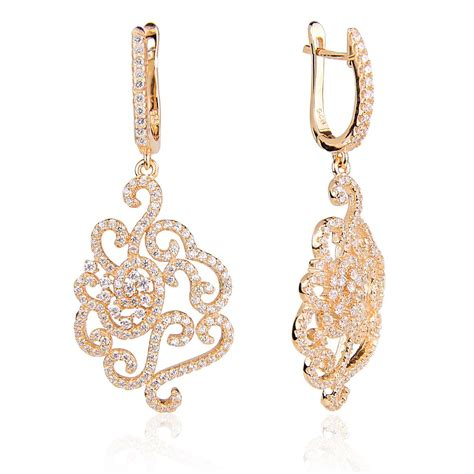 ingenious gold chandelier earrings with pave flower design