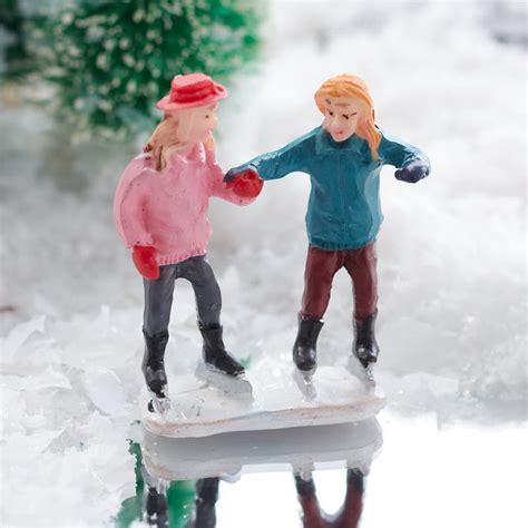 miniature girls ice skating figurine christmas