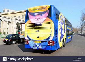Colourful public transport advertisement on back of ...