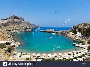St Paul U0026 39 S Bay Beach With The Acropolis Behind  Lindos  Rhodes  Greece Stock Photo