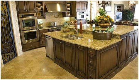 medium brown glazed cabinets with new venetian gold