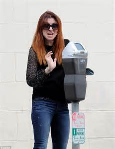 renewing wedding vows make up free alyson hannigan scowls as she struggles with a parking meter daily mail