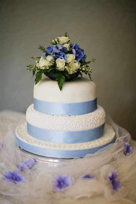 tier wedding cake  blue ribbon