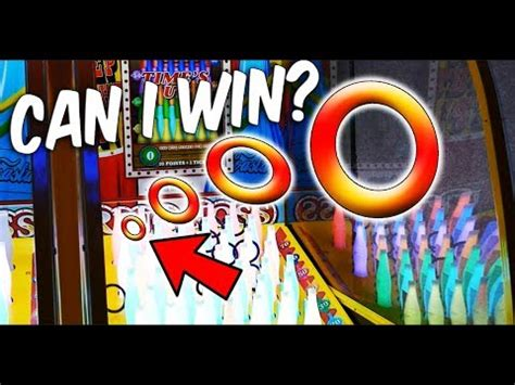 playing  carnival style ring toss arcade game