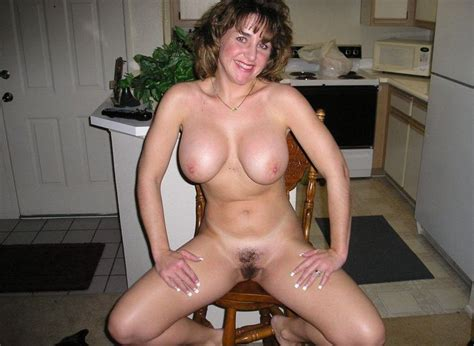 cheerful smiling mom showing her great body her nice