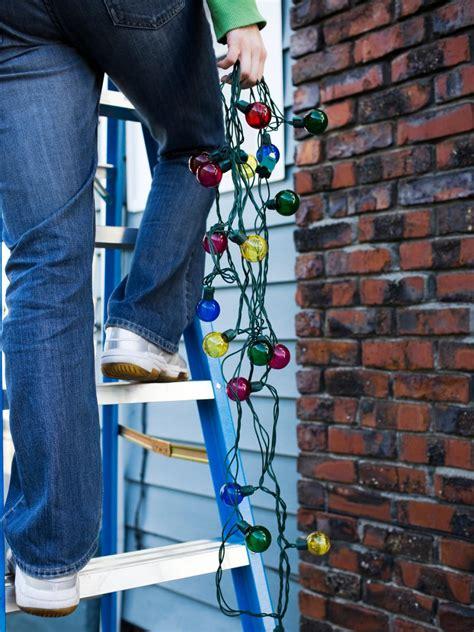 how to put christmas lights on your how to hang christmas lights diy