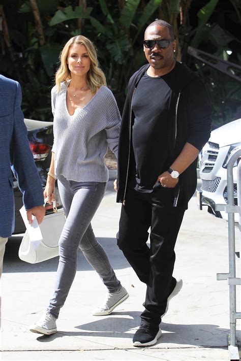 eddie murphy  paige butcher attend  lakers game