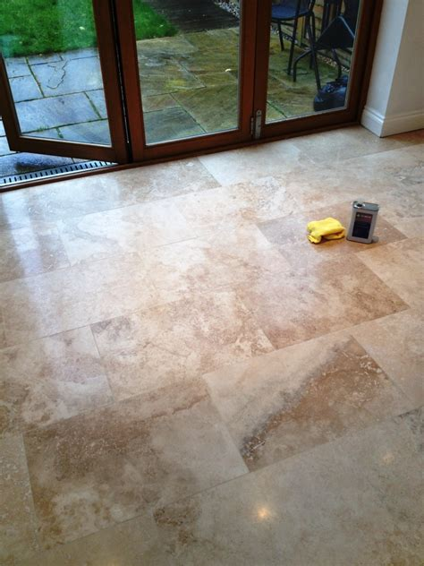 restoring the appearance of a polished travertine tiled