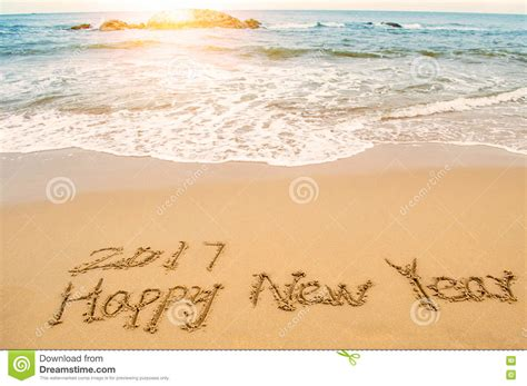 Write Happy New Year 2017 On Beach Stock Image