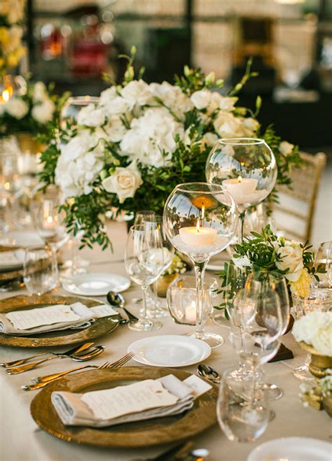 extensive white decorating table for elegant banquet tables were covered with green and white
