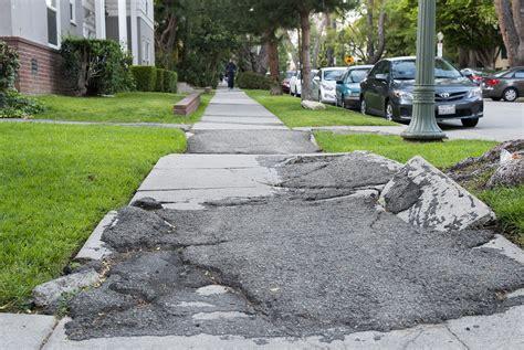 la city council settles lawsuit allots   sidewalk