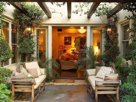 Mediterranean Patio with exterior stone floors Trellis