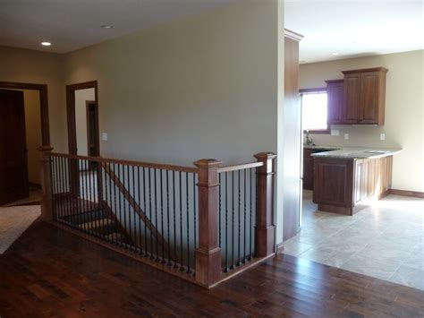 View From Living Area To Open Staircase And Kitchen/dining