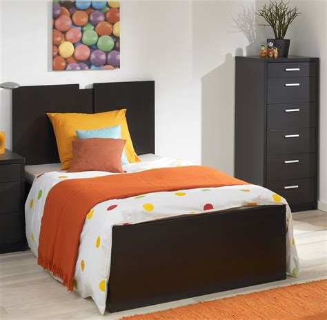 bedroom decorating ideas for a single low profile single bed design with under bed drawer storage also red wall color in minimalist