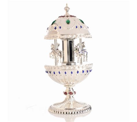 silver plated egg shaped musical carousel ornament with