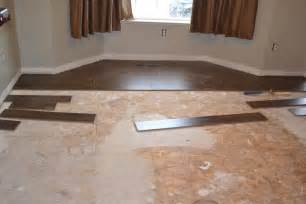 Laying Tile On Concrete Basement Floor by Lay Laminate Flooring In Hallway Your New Floor