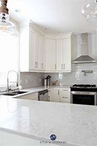 low contrast white kitchen with bianco drift quartz countertops and gray subway tile backsplash kylie m interiors 1499