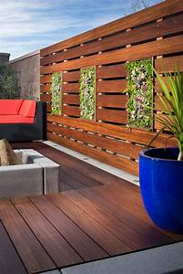 raised, deck, with, foliage, in, wood, retaining, wall