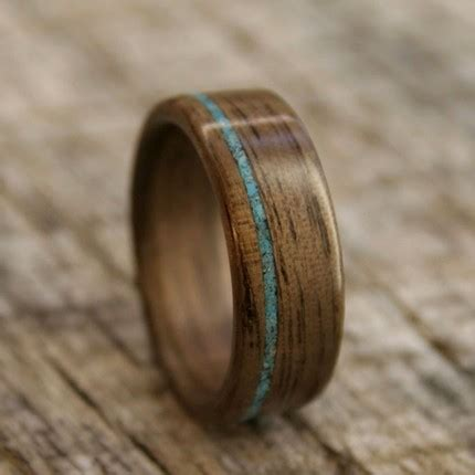 bird in a cage earthy wedding bands