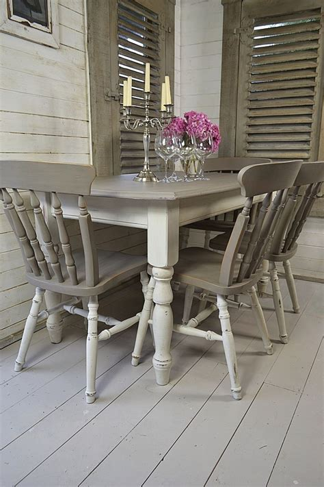 Wood dining table and 6 chairs. Dine in style with our stunning grey and white split ...