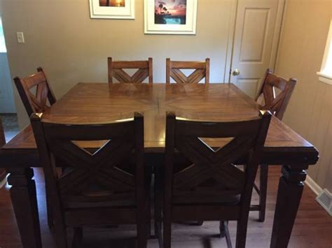 bar height table and 6 chairs flint 48602 saginaw home
