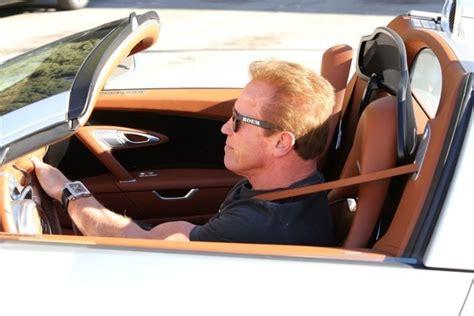 arnold schwarzenegger  driving  bugatti veyron