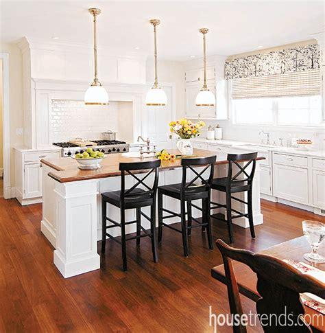 cherry flooring pops   white kitchen