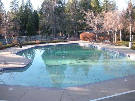 Big Swimming Pool In Modern Hotel Backyard With Handle