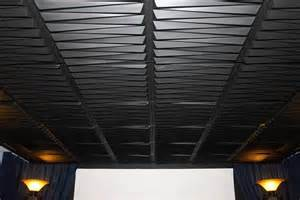 black ceiling tiles and grid