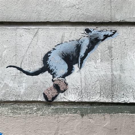 banksy unveils  pieces  paris france updated