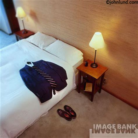 Businessmanu0026#39;s Motel or Hotel Room With Clothes On Bed