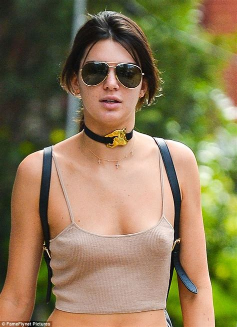 Kendall Jenner Shows Off Supermodel Physique In Tiny Crop Top And Striped Pants Daily Mail Online