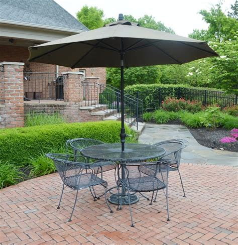wrought iron patio table four chairs and umbrella ebth