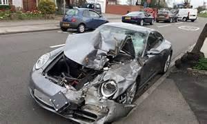 driver distraught    porsche  wrecked
