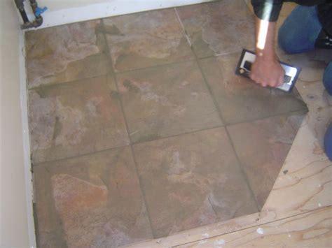 applying grout  ceramic tile floor