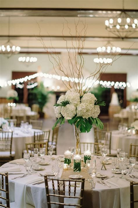 ivory hydrangea palm leaf  curly willow centerpieces